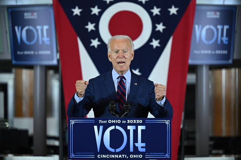 TOPSHOT - Democratic Presidential candidate and former Vice President Joe Biden delivers remarks at a voter mobilization event in Cincinnati, Ohio, on October 12, 2020, where he will speak to the importance of Ohioans making their voices heard this election. / AFP / JIM WATSON