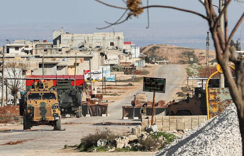 This picture taken on February 1, 2020 shows a view of a Turkish military vehicles at an observation point on the eastern outskirts of the town of Saraqeb, east of Idlib in northwestern Syria, along the motorway leading to Abu Duhur crossing point into the neighbouring Aleppo province.  / AFP / Omar HAJ KADOUR