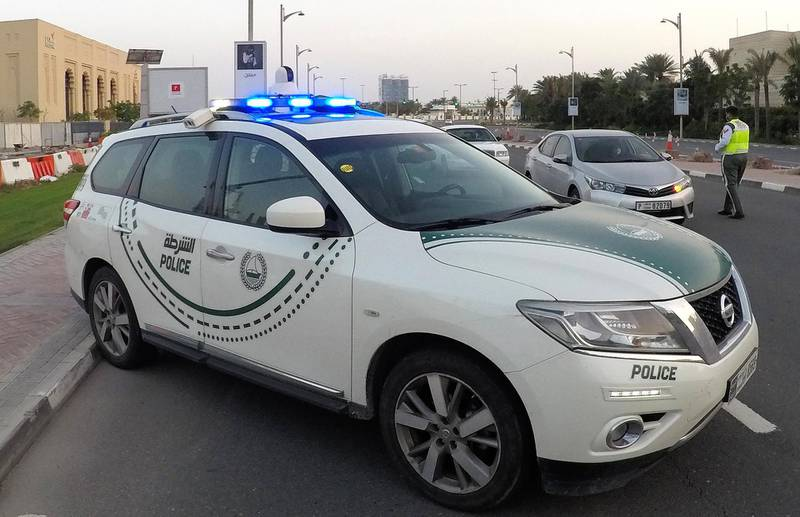 DUBAI, UNITED ARAB EMIRATES , April 16– 2020 :- Dubai Police officer stopping the private vehicles and checking the movement permit near Madinat Jumeirah in Dubai. Dubai is conducting 24 hours sterilisation programme across all areas and communities in the Emirate and told residents to stay at home. UAE government told residents to wear face mask and gloves all the times outside the home whether they are showing symptoms of Covid-19 or not.  (Pawan Singh / The National) For News/Online/Instagram