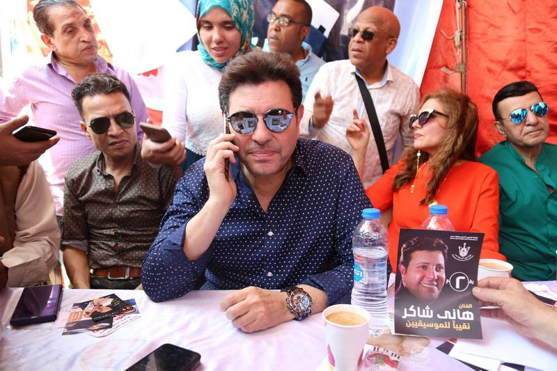 Mandatory Credit: Photo by MAHMOUD AHMED/EPA-EFE/Shutterstock (10351121b) Head of Egypt's Music Syndicate Hany Shaker (C) attends voting process to elect board members of the Egyptian Musicians Syndicate, in Cairo, Egypt, 30 July 2019 (issued 31 July 2019). Hany Shaker was re-elected for a second term as head of the Egyptian Musicians Syndicate. Electing board members of the Egyptian Musicians syndicate, Cairo, Egypt - 30 Jul 2019