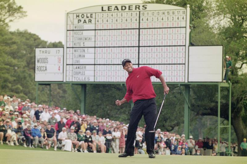 Tiger Woods of the United States celebrates after sinking a 4 feet putt to win the US Masters Golf Tournament with a record low score of 18 under par 13 April 1997 at the Augusta National Golf Club in Augusta, Georgia, United States. (Photo by Stephen Munday/Allsport/Getty Images)