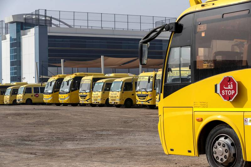 DUBAI, UNITED ARAB EMIRATES. 08 APRIL 2020. Unused school busses stand idle at the GEMS Wellington International School in al Sufouh. (Photo: Antonie Robertson/The National) Journalist: Standalone. Section: National.