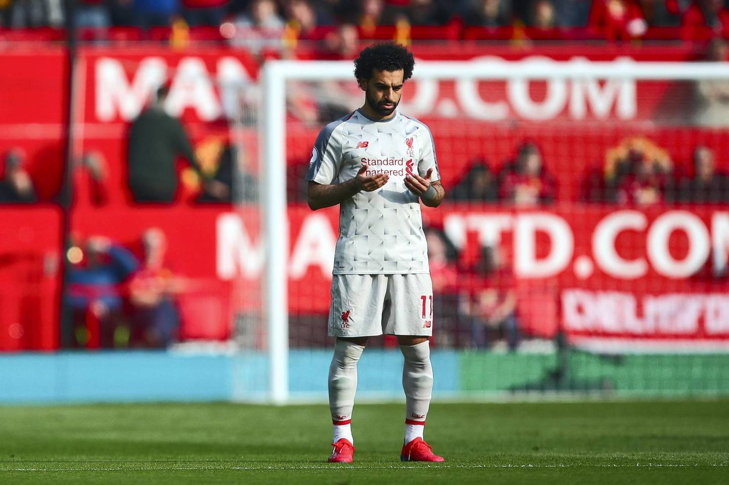 MANCHESTER, ENGLAND - FEBRUARY 24: Mohamed Salah of Liverpool prays during the Premier League match between Manchester United and Liverpool FC at Old Trafford on February 24, 2019 in Manchester, United Kingdom. (Photo by Robbie Jay Barratt - AMA/Getty Images)