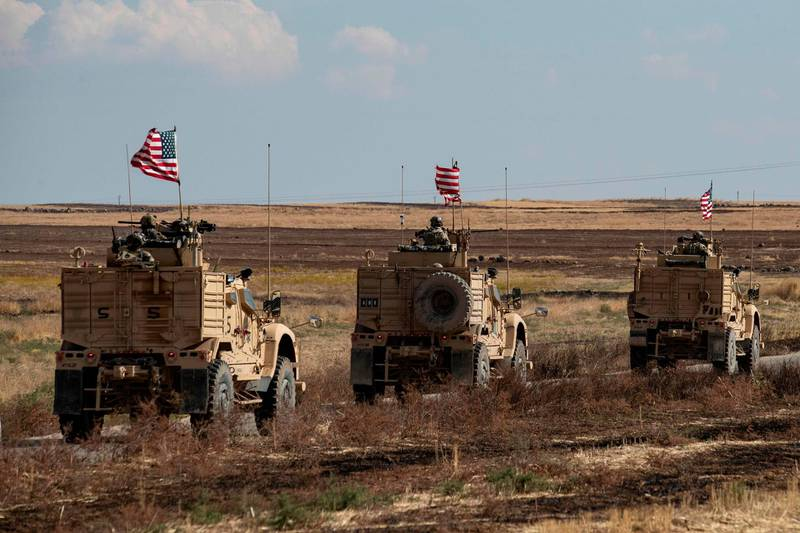 A convoy of US armoured vehicles patrols the northern countryside of the northeastern Syrian town of al-Malikiyah (Derik) at the border with Turkey, on November 3, 2019.  / AFP / Delil SOULEIMAN