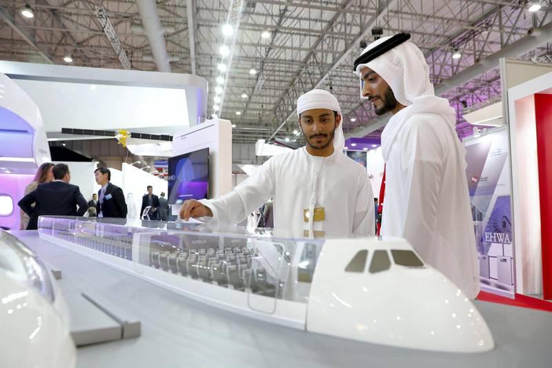 Dubai, United Arab Emirates - November 14th, 2017: Visitors look at a open top model of an Airbus A380 at the Dubai airshow. Tuesday, November 14th, 2017 at Al Maktoum Airport, Dubai. Chris Whiteoak / The National