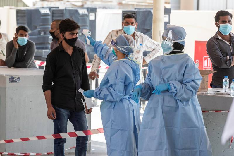 ABU DHABI, UNITED ARAB EMIRATES. 16 APRIL 2020. COVID-19 Testing station in Al Mussafah. Medical staff pre-check individuals ahead of the actual COVID-19 test. (Photo: Antonie Robertson/The National) Journalist: Haneen Dajani. Section: National.