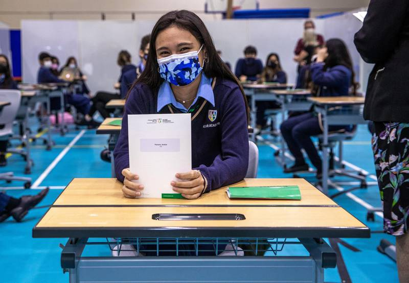 Abu Dhabi, United Arab Emirates, March 3, 2021.  Pupils receive some of their IGCSE and International A-level results for January session 2021. Pupils celebrating after recieving receiving results.  --  Jessica Parsons happy with her grade.Victor Besa / The NationalSection:  NAReporter:  Anam Rizvi