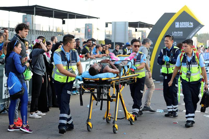 Abu Dhabi, United Arab Emirates - December 06, 2019: An athlete is stretchered off after finishing the mens ADNOC Abu Dhabi marathon 2019. Friday, December 6th, 2019. Abu Dhabi. Chris Whiteoak / The National