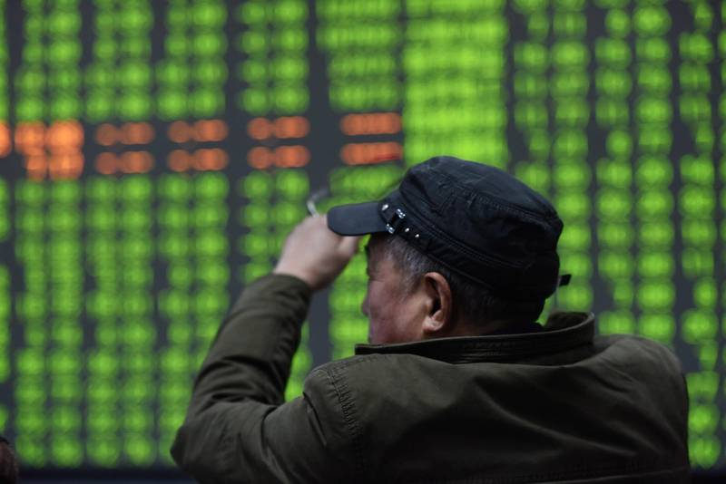epa08189745 A stock investor sits in front of a display screen at a brokerage house in Hangzhou, Zhejiany province, China, 03 February 2020.  China's stock market plunged by 7.72 percent on 03 February after a ten-day break, for Chinese New Year, when the novel coronavirus outbreak occurred.  EPA/LONG WEI CHINA OUT