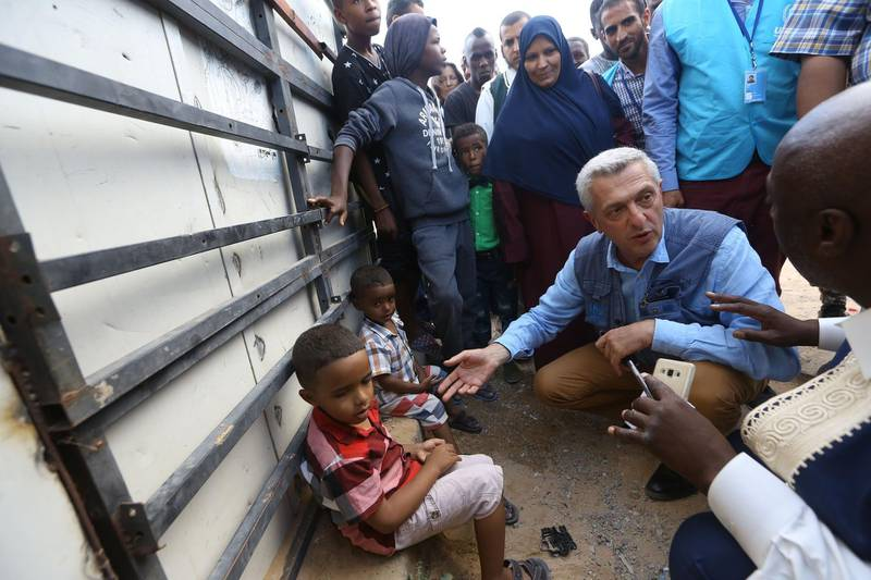 Filippo Grandi (2nd R), the United Nations High Commissioner for Refugees, visits a refugee camp providing temporary shelter to Libyans who were displaced from the town of Tawergha, near the Libyan capital Tripoli on June 18, 2018. / AFP / MAHMUD TURKIA