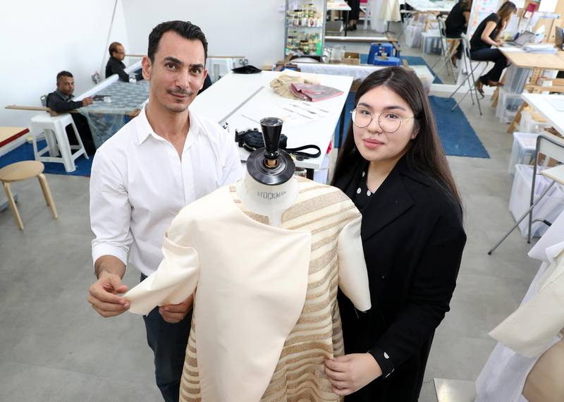 Dubai, United Arab Emirates - August 23rd, 2017: A feature on fashion designer Rami Al Ali (L) & Karashash Nurakhmet a ESMOD fashion school intern. Karashash is designing clothes which will then be sold, and Rami Al Ali is helping lend his industry knowledge. Wednesday, August 23rd, 2017 at The Design District, Dubai. Chris Whiteoak / The National
