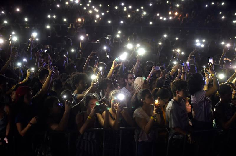 epaselect epa06970186 People rise up their illuminated cell phones as Lebanese alternative rock band Mashrou' Leila perform on stage during a concert at the Amchit International Festival in Amchit north of Beirut, Lebanon, 24 August 2018. The festival runs from 23 to 26 August. Mashrou' Leila is a Lebanese five-member alternative rock band, formed in Beirut, Lebanon in 2008 as a music workshop at the American University of Beirut (AUB).  EPA/WAEL HAMZEH