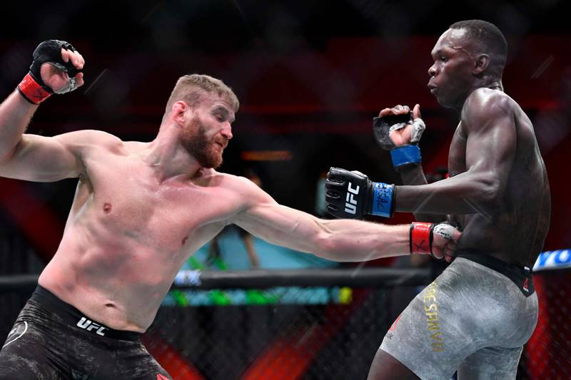 LAS VEGAS, NEVADA - MARCH 06: (L-R) Jan Blachowicz of Poland punches Israel Adesanya of Nigeria in their UFC light heavyweight championship fight during the UFC 259 event at UFC APEX on March 06, 2021 in Las Vegas, Nevada. (Photo by Chris Unger/Zuffa LLC)