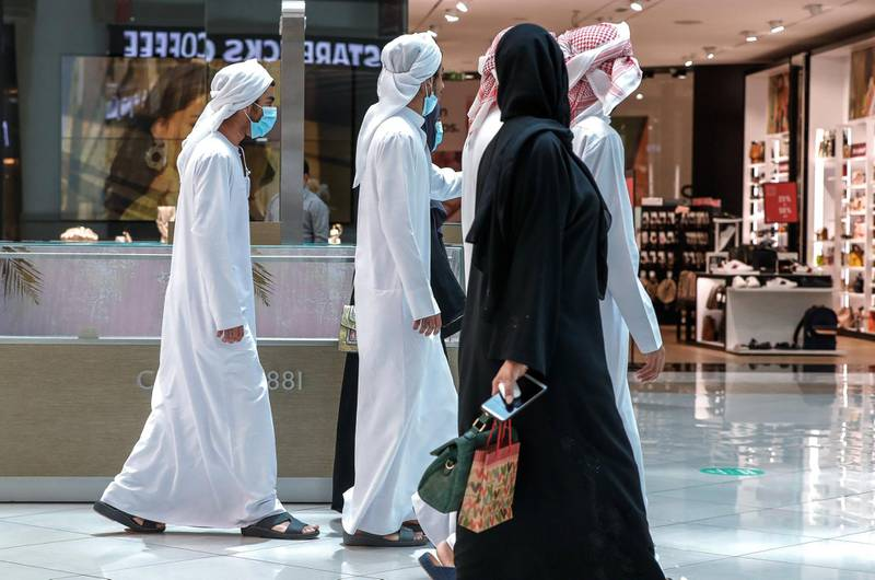 Abu Dhabi, United Arab Emirates, August 2, 2020.    A family goes malling at Al Wahda Mall on the last day of Eid Al Adha. Victor Besa /The NationalSection: NAFor:  Standalone/Stock Images