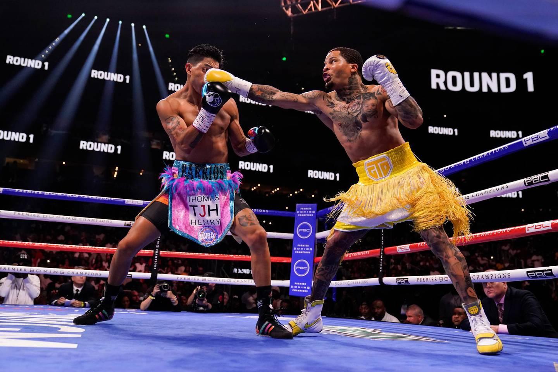 Gervonta Davis, right, hits Mario Barrios during the WBA Super Lightweight world championship boxing match on Sunday, June 27, 2021, in Atlanta. Davis won. (AP Photo/Brynn Anderson)