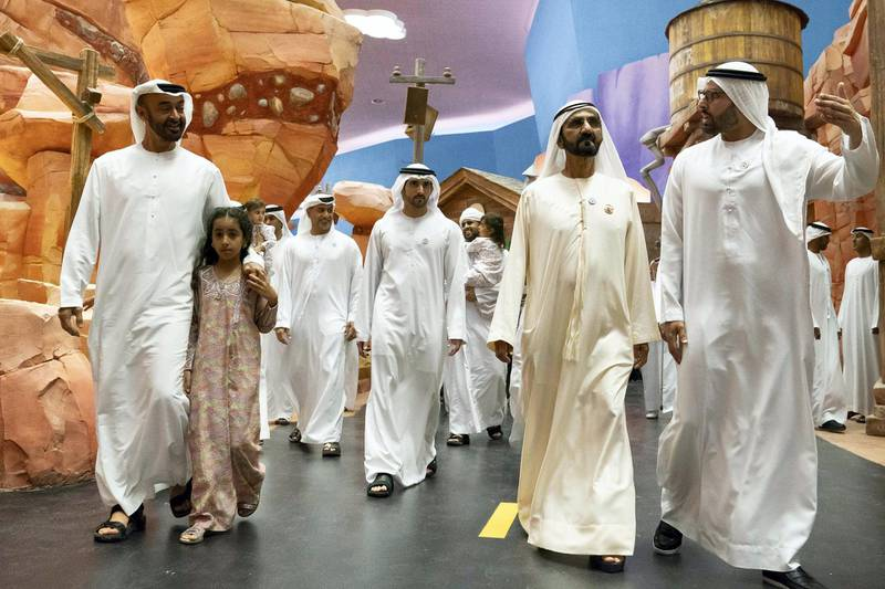 YAS ISLAND, ABU DHABI, UNITED ARAB EMIRATES - July 23, 2018: HH Sheikh Mohamed bin Zayed Al Nahyan, Crown Prince of Abu Dhabi and Deputy Supreme Commander of the UAE Armed Forces (L), HH Sheikha Fatima bint Mohamed bin Hamad bin Tahnoon Al Nahyan(2nd L), HH Sheikh Mohamed bin Rashid Al Maktoum, Vice-President, Prime Minister of the UAE, Ruler of Dubai and Minister of Defence (2nd R) and HE Mohamed Khalifa Al Mubarak, Chairman of the Department of Culture and Tourism and Abu Dhabi Executive Council Member (R), attend the opening of Warner Bros. World Abu Dhabi. Seen with HH Sheikh Hamdan bin Mohamed Al Maktoum, Crown Prince of Dubai (back).   ( Hamad Al Kaabi / Crown Prince Court - Abu Dhabi ) ---
