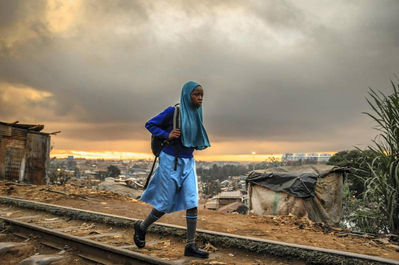 NAIROBI, KENYA - 2019/10/01: A girl finds her way to school on an early morning in Kibera Slums. As the world comes to one of its most remarkable days (World childrens day). Most children around different places of the world are seen sharing their lovely moments and togetherness. This is a moment that not many children around different parts of the word live to see or enjoy. Today in Kenya Children are seen sharing and enjoying their free world moments peacefully and forgetting the day to day struggles in Life despite everyday challenges. (Photo by Donwilson Odhiambo/SOPA Images/LightRocket via Getty Images)