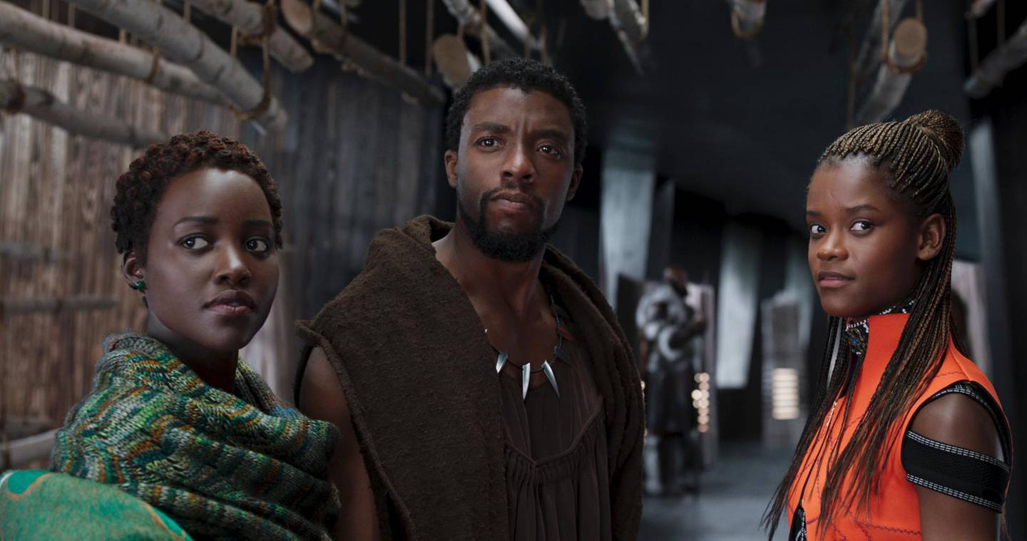 """This image released by Disney shows Lupita Nyong'o, from left, Chadwick Boseman and Letitia Wright in a scene from """"Black Panther."""" The cast was nominated for a SAG Award for best ensemble. The SAG Awards will be held Jan. 27 and broadcast live by TNT and TBS. This year's show will honor Alan Alda with the Screen Actors Guild Life Achievement Award. (Disney via AP)"""