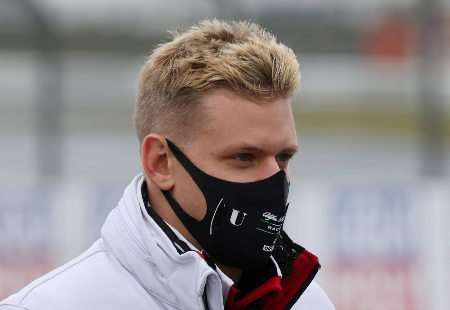 FILE PHOTO: Formula One F1 - Eifel Grand Prix - Nurburgring, Nurburg, Germany - October 8, 2020   Alfa Romeo's Mick Schumacher on the circuit wearing a protective face mask with his team ahead of the Grand Prix   REUTERS/Wolfgang Rattay/File Photo