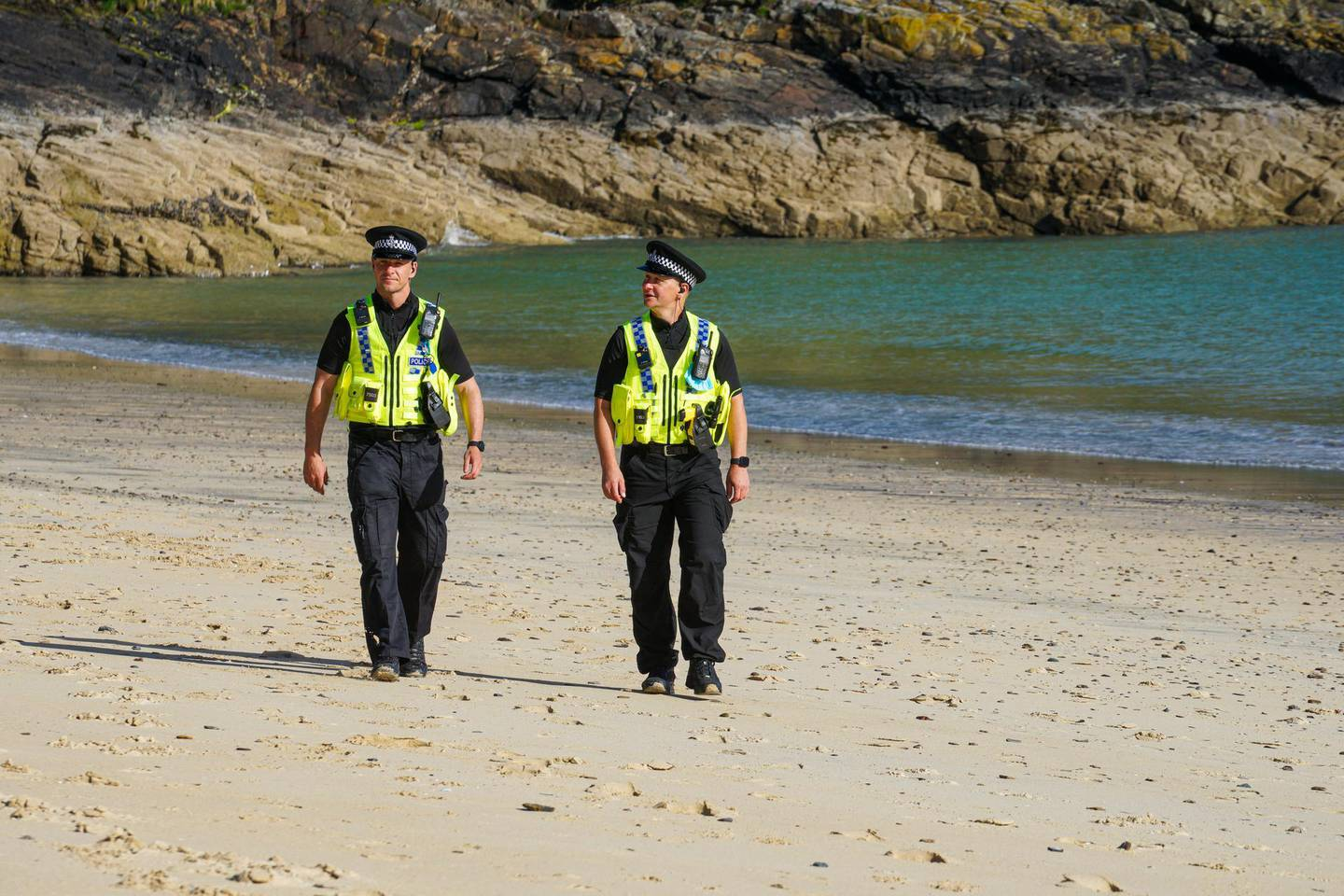 CARBIS BAY, CORNWALL - JUNE 03: Police officers patrol on the beach in front of the Carbis Bay Hotel, host venue for the G7 Summit conferences, on June 03, 2021 in Carbis Bay, Cornwall. On June 11, Prime Minister Boris Johnson will host the Group of Seven leaders at a three-day summit in Cornwall, as the wealthiest nations look to chart a course for recovery from the global pandemic.  (Photo by Hugh Hastings/Getty Images)
