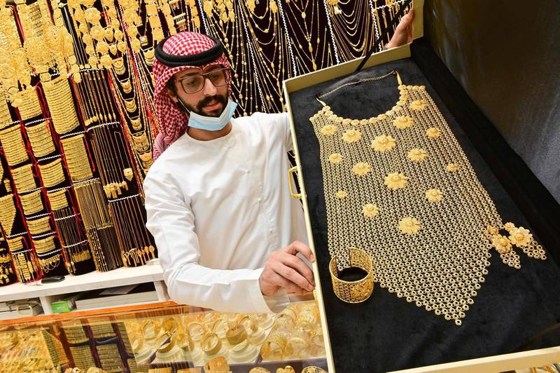 A merchant displays gold jewellery at his shop in Dubai Gold Souk in the Gulf emirate on July 29, 2020.  / AFP / GIUSEPPE CACACE