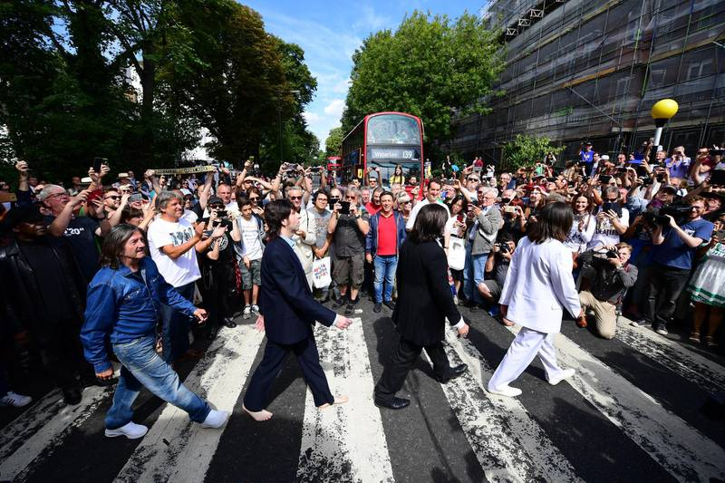 ***BESTPIX*** LONDON, ENGLAND - AUGUST 08: Beatles impersonators recreate the iconic 'Abbey Road' photograph made 50 years ago today, on August 8, 2019 in London, England. 50 years ago today, John Lennon, Paul McCartney, George Harrison and Ringo Starr held up traffic on the zebra crossing outside their recording studio in north London to get the cover shot for the album, Abbey Road. (Photo by Leon Neal/Getty Images)