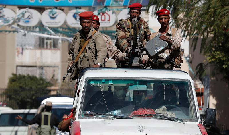 epa09019307 Pro-Houthi soldiers ride a truck as they patrol in Sana'a, Yemen, 17 February 2021. Yemen has been in the grip of an escalating fighting since late 2014 after the Houthis gained control of most of the northern part of Yemen and forced the Saudi-backed Yemeni government into exile.  EPA/YAHYA ARHAB
