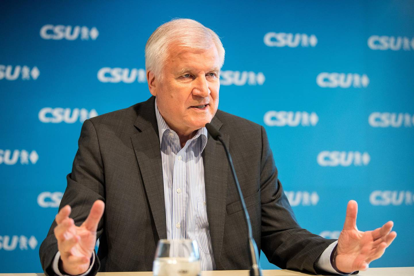 epa06818720 German Interior Minister Horst Seehofer speaks during a press conference after the CSU board meeting in Munich, Bavaria, Germany, 16 June 2018. The CDU and their Bavarian sister party Christian Social Union (CSU) are still discordant regarding the treatment of refugees. The CSU party board met in Munich to discuss the Migration Masterplan of German Interior Minister Horst Seehofer  EPA/MARC MUELLER