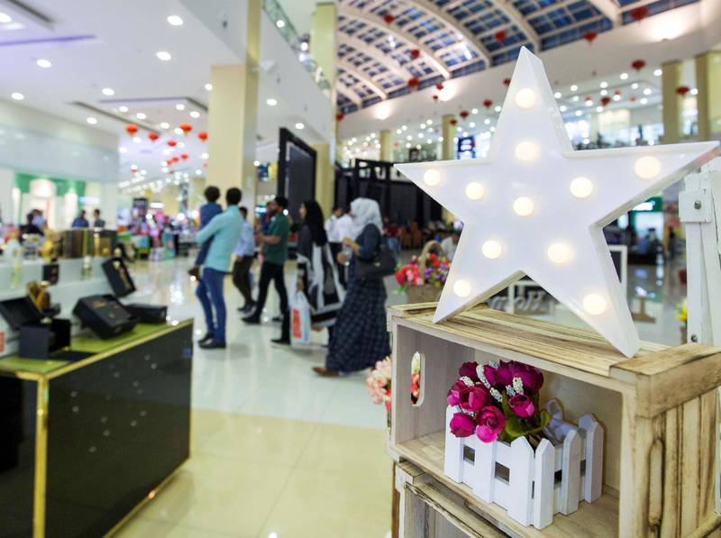 DUBAI, UNITED ARAB EMIRATES, 04 May 2018 - Shoppers checking out items at Ramadan Market, Dragon Mart 2.  Leslie Pableo for The National for Ellen Fortini's story