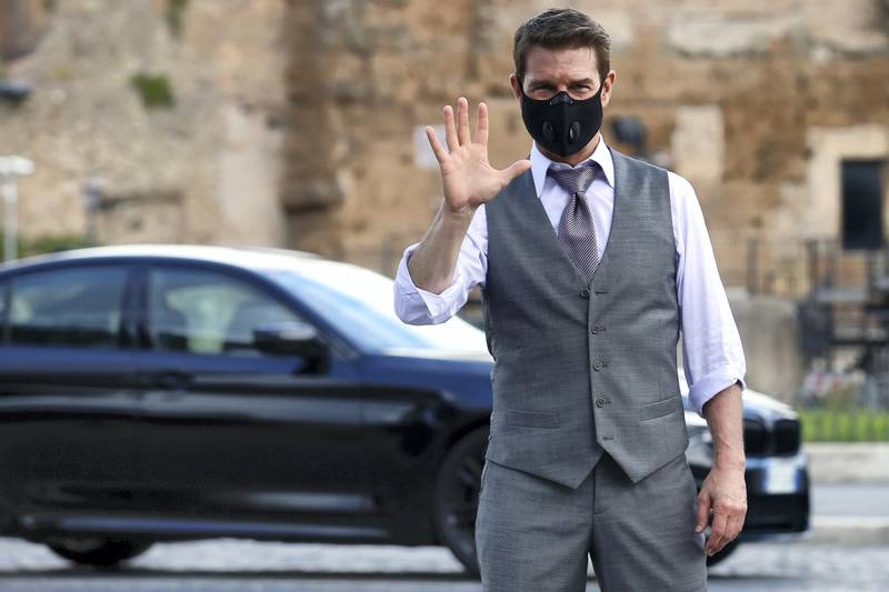 Actor Tom Cruise wearing a face mask waves at his fans  on the set of the film Mission Impossible 7 at Imperial Fora in Rome. Rome (Italy), October 12th 2020 (Photo by Samantha Zucchi/Insidefoto/Mondadori Portfolio via Getty Images)