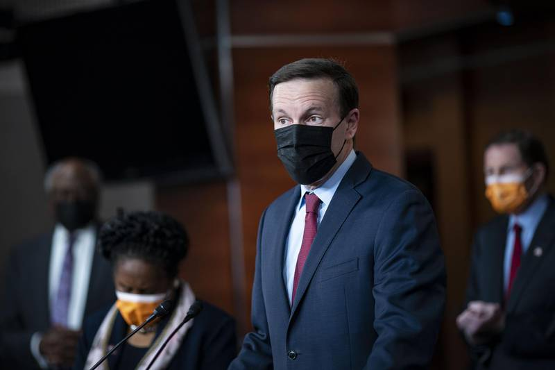 Senator Chris Murphy, a Democrat from Connecticut, wears a protective mask as he speaks during a news conference at the U.S. Capitol in Washington, D.C., U.S., on Thursday, March 11, 2021. President Biden's $1.9 trillion Covid-19 relief bill cleared its final congressional hurdle Wednesday, with the House passing the bill on a 220-to-211 vote, sending it to the president for his signature. Photographer: Al Drago/Bloomberg