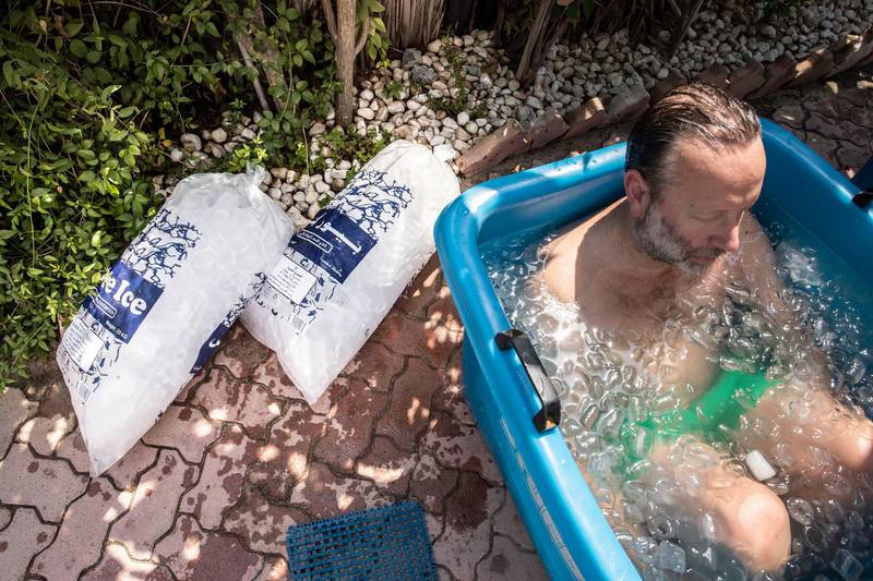 """ICE BATH PICTURE STORY: Extra ice is kept close at hand to replenish the ice batjhs as the moring ambient temperature rises to a bright 40 celcius while participants continue to duck into the ice. Deep breathing and ice bath therapy for health benefits with Benoit Demeulemeester from @cooloutbreathin following the now internationally acclaimed Wim Hof """"Ice Man"""" Method where special breathing exertions are employed along with submerging the the body, up to the shoulders, in a bath of ice to """"keep ones body in an optimal condition"""". Photographed in Dubai on June 5th, 2021. Antonie Robertson / The National.Reporter: Antonie Robertson for National"""