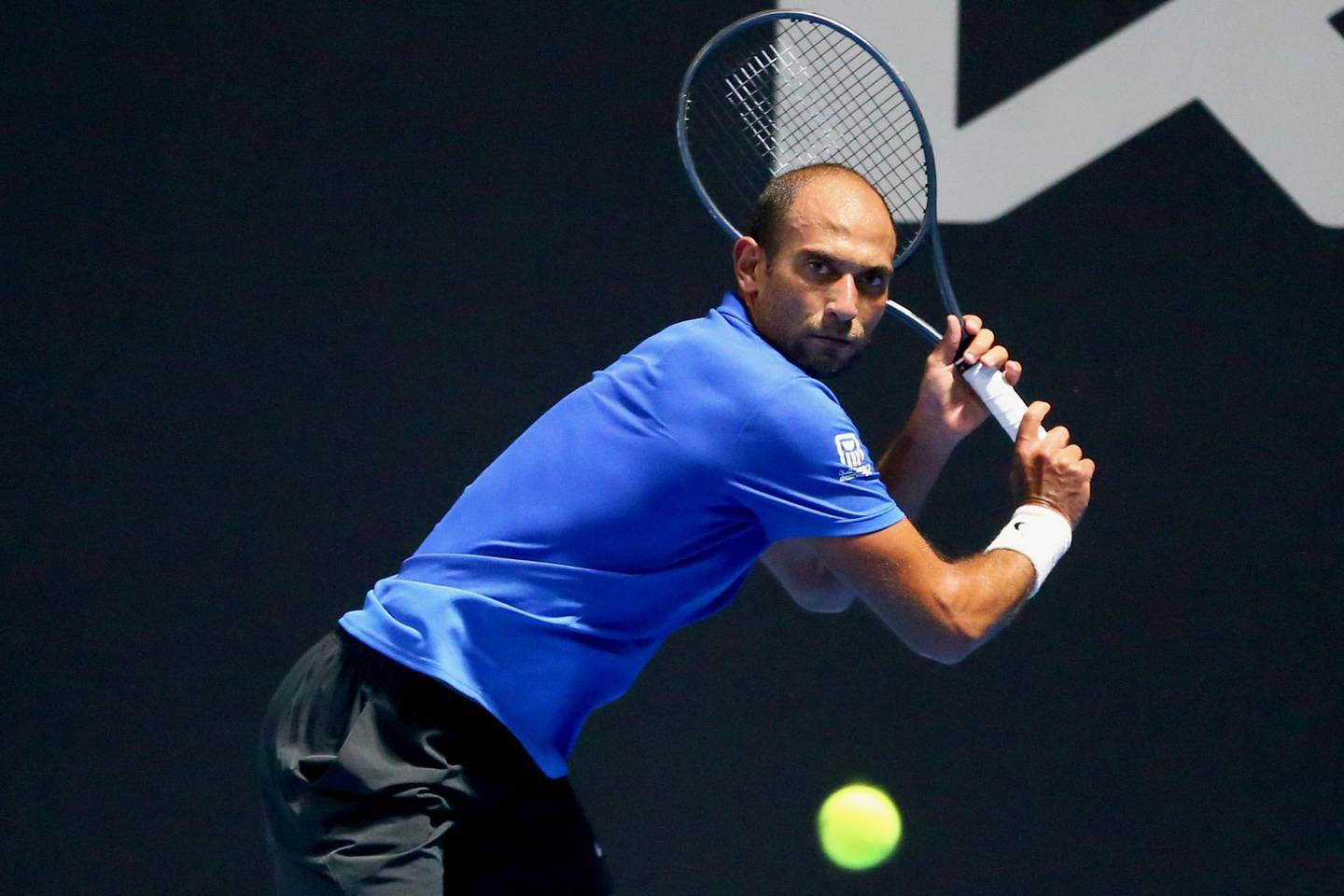 Mohamed SAFWAT (EGY) playing against Arthur DE GREEF (BEL) in their round 1 match on court 2 at the Australian Open 2021 Men's Qualifying at the Khalifa International Tennis and Squash Complex in Doha, Qatar, Sunday, January 10, 2021. Tennis Australia Photo by Samer Alrejjal