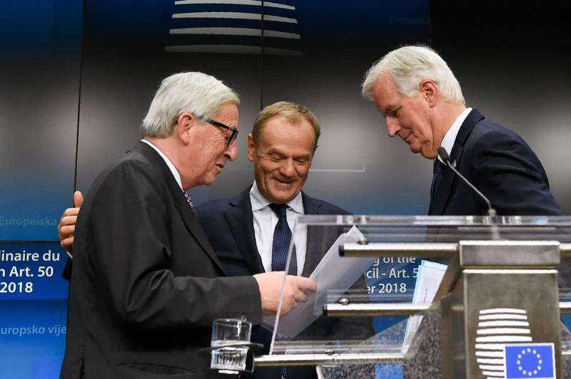 """President of the European Commission Jean-Claude Juncker (L), EU chief Brexit negotiator Michel Barnier (R) and European Council President Donald Tusk (C) congratulate each other at the end of a press conference following a special meeting of the European Council to endorse the draft Brexit withdrawal agreement and to approve the draft political declaration on future EU-UK relations on November 25, 2018 in Brussels. - The European Union's top official urged British lawmakers to ratify the Brexit deal Prime Minister Theresa May has negotiated with European leaders, warning it will not be modified. """"This is the best deal possible for Britain, this is the best deal possible for Europe. This is the only deal possible,"""" Jean-Claude Juncker, the president of the European Commission, said after a Brussels summit. (Photo by JOHN THYS / AFP)"""
