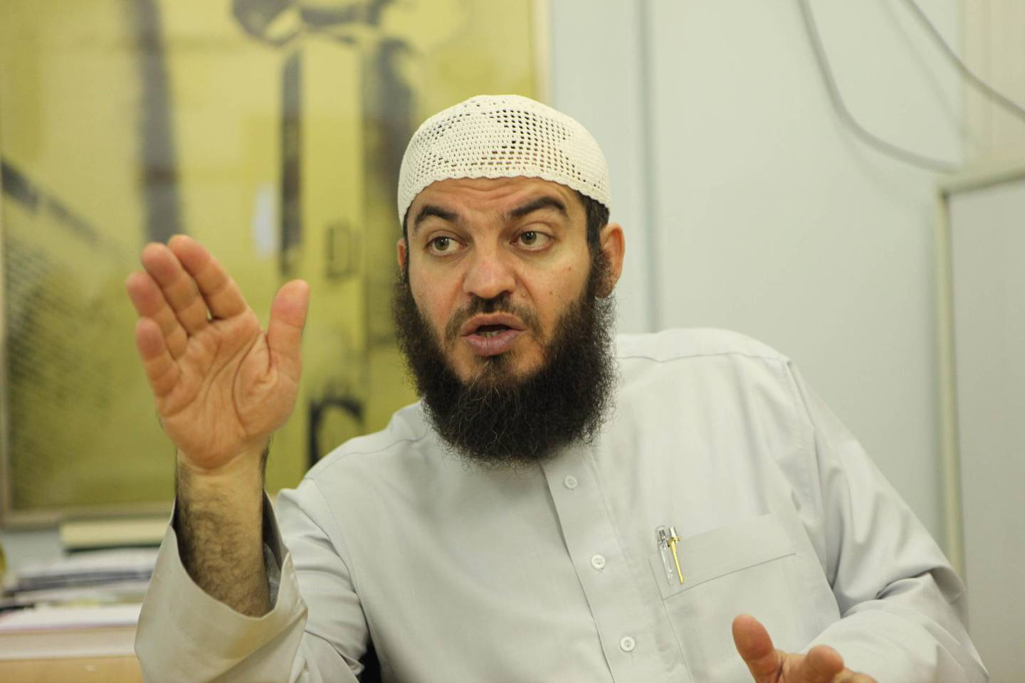 Sheikh Haitham Al-Haddad of the Islamic Sharia Council in the room they use for counselling (they try not to call it a court) in the Masjid & Madrasah al-Tawhid (Mosque) in Leyton, east London, while their own building is being re-built.  Photograph by Jonathan Player for The National, November 23rd 2009.