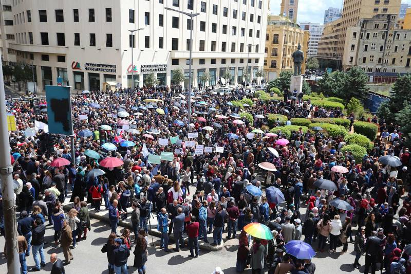 epa07512173 Civil servants protest near the government building against any cuts to their salaries, Beirut, Lebanon, 17 April 2019. Reports state the government is discussing austerity measures to avoid a financial and economic crisis.  EPA/WAEL HAMZEH