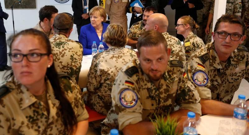 German Chancellor Angela Merkel talks with German soldiers stationed in Jordan, June 21, 2018. REUTERS/Muhammad Hamed