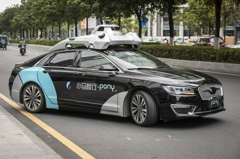 A Pony.ai Inc. autonomous vehicle travels along a road during a demonstration in the Nansha district of Guangzhou, Guangdong Province, China, on Wednesday, April 10, 2019. Domestic and foreign testers are putting cars, buses, trucks and delivery vans through self-driving trials to teach them how to navigate the notoriously congested streets of the world's biggest auto market. Photographer: Qilai Shen/Bloomberg