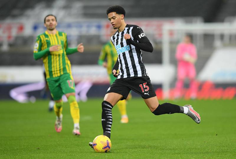 NEWCASTLE UPON TYNE, ENGLAND - DECEMBER 12: Jamal Lewis of Newcastle United in action during the Premier League match between Newcastle United and West Bromwich Albion at St. James Park on December 12, 2020 in Newcastle upon Tyne, England. The match will be played without fans, behind closed doors as a Covid-19 precaution. (Photo by Stu Forster/Getty Images)