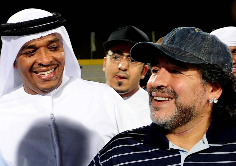 Football legend Diego Maradona (R) visits the Al-Wasl football club of the United Arab Emirates, on May 14, 2011 in Dubai. Al-Wasl club announced on May 16, 2011 that 50-year-old Maradona is to take over as coach next season. AFP PHOTO/STR (Photo by STR / AFP)