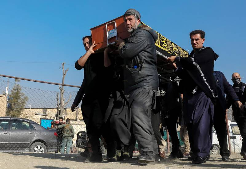 epa08943340 People carry the coffin of an Afghan female judge in Kabul, Afghanistan on 17 January 2021. According to the reports, at least two female judges of the Supreme Court were killed and two other injured, the slain judges were on their way to work in the morning when unknown assailants ambushed and fired on their official vehicle. The latest attack comes two days after the Pentagon announced it cut American troop levels in Afghanistan to 2,500, the lowest in nearly two decades.  EPA/HEDAYATULLAH AMID