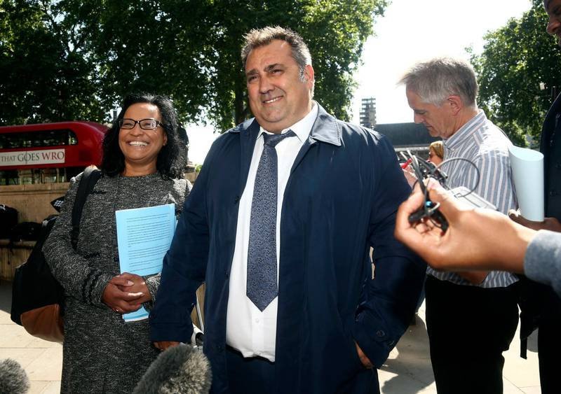 Former Pimlico Plumbers employee Gary Smith leaves the UK Supreme Court, Parliament Square, London, Wednesday, June 13, 2018. A London plumber who claimed he was unfairly dismissed after years of working as a contractor has won a court ruling giving him employment rights, in a case seen as a key test of labor rules in the so-called gig economy. Britain's Supreme Court upheld a ruling by a lower court saying that Gary Smith, who worked for Pimlico Plumbers full-time for six years, was entitled to rights such as sick pay. (Yui Mok/PA via AP)