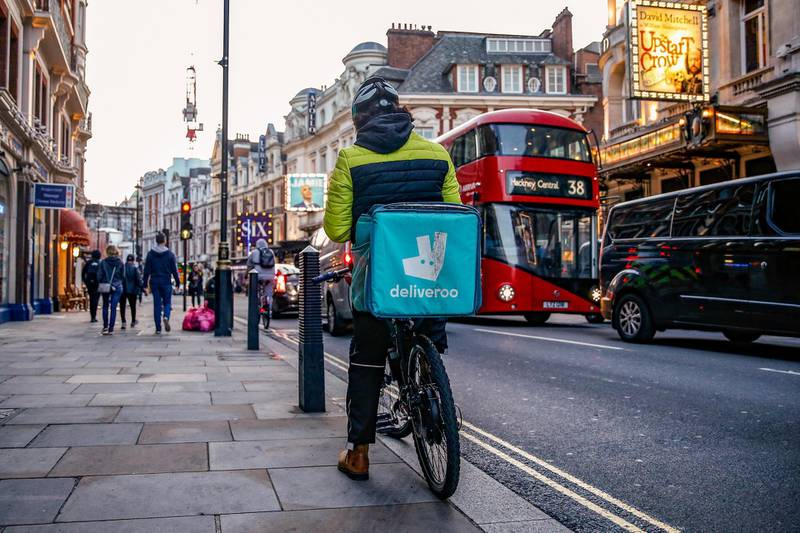 A takeaway food courier, working for Deliveroo, operated by Roofoods Ltd., cycles in the Soho district of London, U.K., on Tuesday, Sept. 29, 2020. Covid-19 lockdown enabled online and app-based grocery delivery service providers to make inroads with customers they had previously struggled to recruit, according the Consumer Radar report by BloombergNEF. Photographer: Hollie Adams/Bloomberg via Getty Images