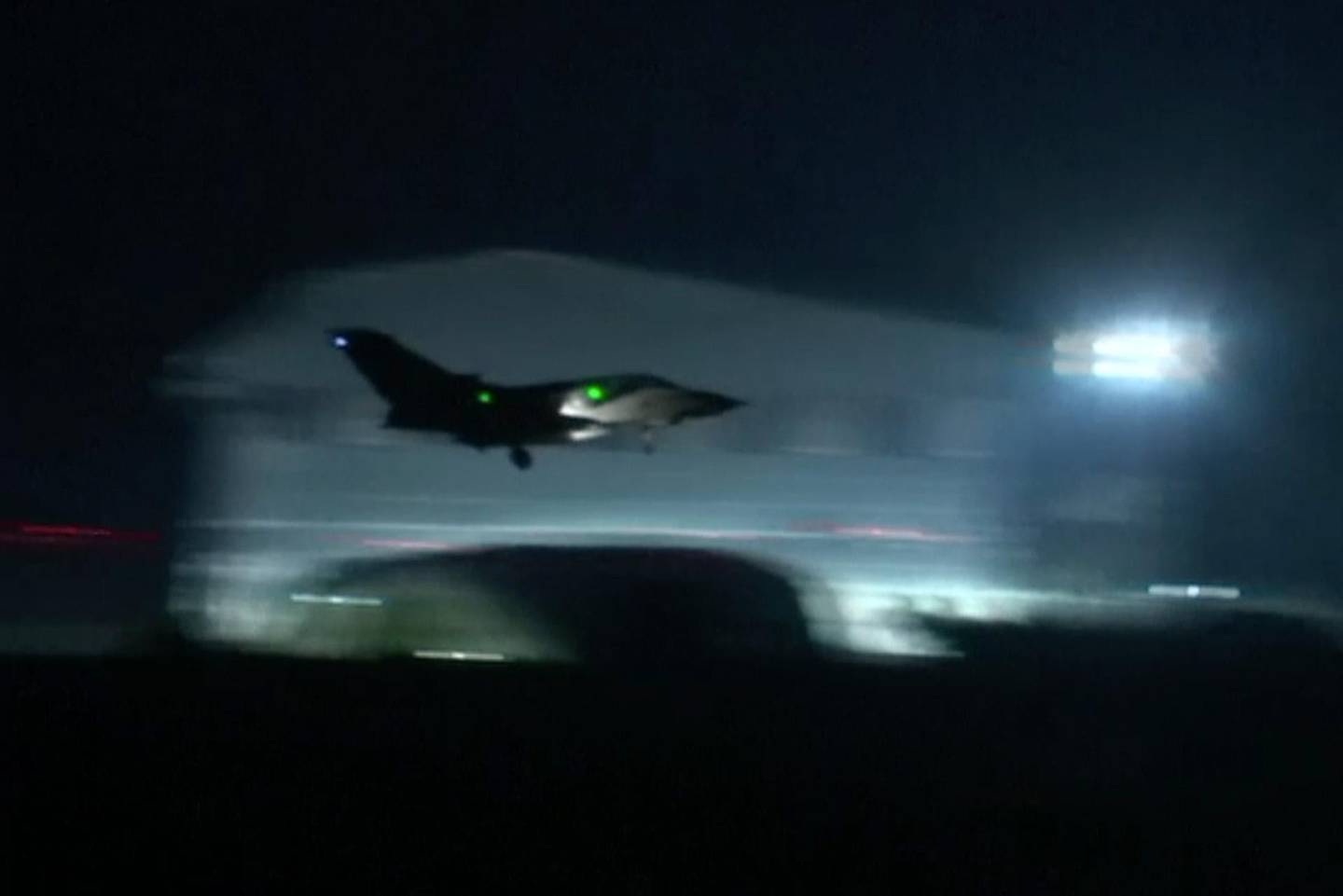 This image made from video shows a fighter jet landing at Akrotiri military British Royal Air Force Base, Cyprus, Saturday, April 14, 2018.  Fighter jets were seen taking off from a British Royal Air Force (RAF) base in Cyprus early on Saturday morning. Their destination was not revealed. The jets landed to Akrotiri Military Base, Cyprus, after the US President Donald Trump's announcement that the US, France and Britain together launched military strikes in Syria to punish President Bashar Assad for his alleged use of chemical weapons against civilians and to deter him from doing it again.(AP Video)