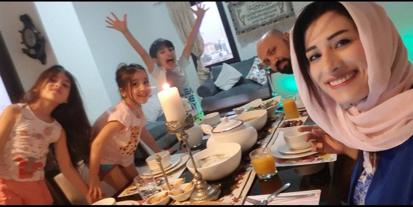 Nesreen Alabbas, an elementary Arabic teacher at American Academy for Girls, sits down for iftar with her family. Courtesy:Nesreen Alabbas