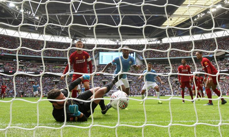 Soccer Football - FA Community Shield - Manchester City v Liverpool - Wembley Stadium, London, Britain - August 4, 2019  Manchester City's Raheem Sterling scores their first goal as Liverpool manager Juergen Klopp looks dejected   REUTERS/David Klein