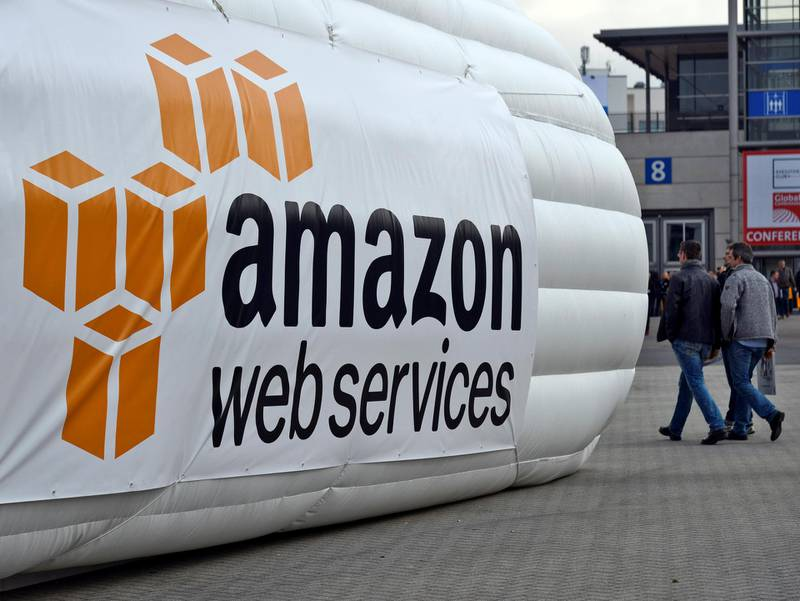 epa07269321 (FILE) - Trade fair visitors pass an inflatable stand promoting amazon web services at the CeBIT computer show in Hanover, Germany, 16 March 2016 (reissued 08 January 2019). Reports on 08 January 2019 state Amazon has reached the world's most valuable company status at the close of US stock markets on Monday, 07 January 2019. Amazon eclipsed Microsoft's market value of 789 billion USD and rose to the top of list with 797 billion USD in market value.  EPA-EFE/MAURITZ ANTIN *** Local Caption *** 54881640