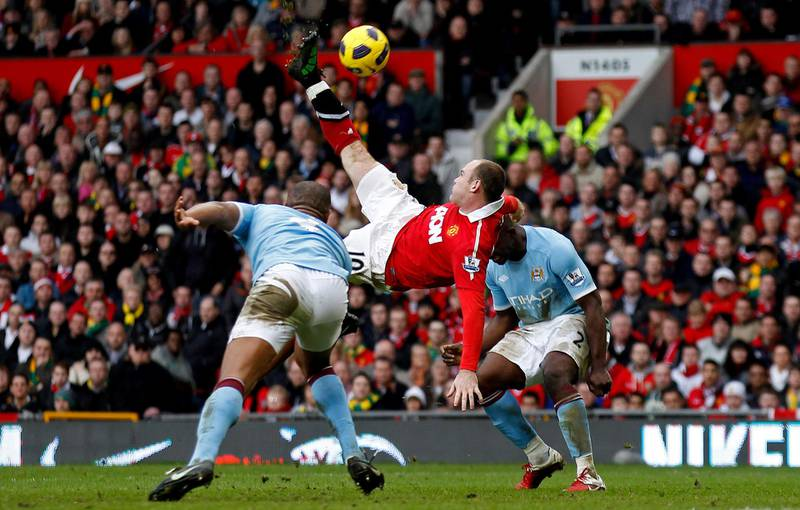 FILE PHOTO: Football - Manchester United v Manchester City Barclays Premier League - Old Trafford - 10/11 - 12/2/11   Wayne Rooney scores the second goal for Manchester United   Mandatory Credit: Action Images / Jason Cairnduff   Livepic   NO ONLINE/INTERNET USE WITHOUT A LICENCE FROM THE FOOTBALL DATA CO LTD. FOR LICENCE ENQUIRIES PLEASE TELEPHONE +44 (0) 207 864 9000./File Photo