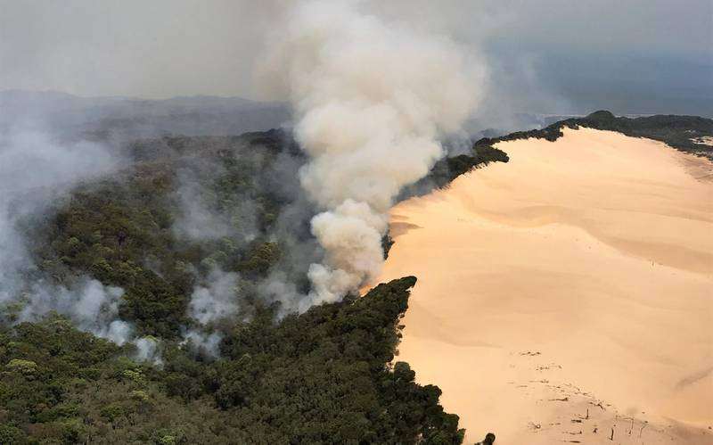 (EDITORS NOTE: Best quality image available.) In this handout image provided by Queensland Fire and Emergency Services (QFES), bushfires continue to burn on November 30, 2020 on Fraser Island, Australia. Queensland Fire and Emergency Services continue to work to contain a bushfire that has been burning on Fraser Island for six weeks, and is now threatening areas with 1,000-year-old trees.  Fraser Island, also known as K'gari, is world heritage listed and the world's largest sand island The fire started in mid-October after an illegal campfire and has since burned across 81,000 hectares of the island. (Photo by Queensland Fire and Emergency Services (QFES) via Getty Images)