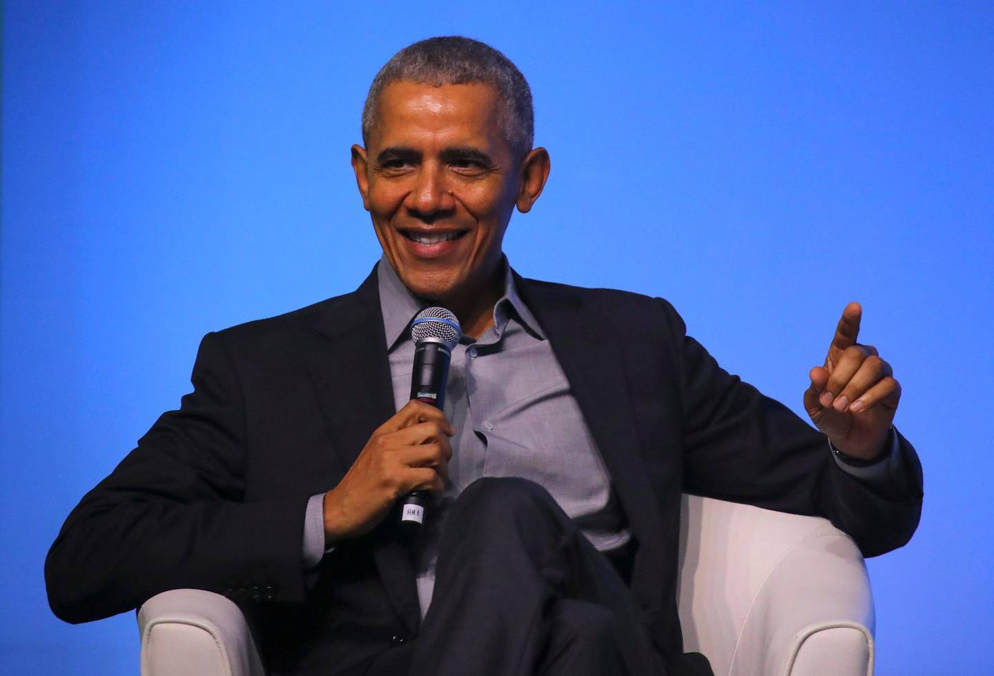 epa08067536 Former US president Barack Obama talks on stage at an Obama Foundation event in Kuala Lumpur, Malaysia, 13 December 2019. Obama and his wife Michelle are in Kuala Lumpur for the inaugural Leaders: Asia-Pacific conference, focused on promoting women's education in the region.  EPA/FAZRY ISMAIL